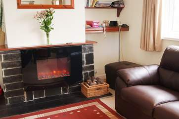 The modern flat screen electric fire gives a warm glow and warms your toes on the cooler evenings.