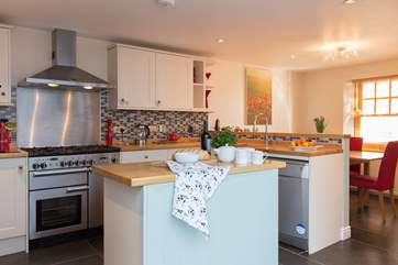 There is a wonderfully sociable kitchen/dining-room, equipped with all that you could possibly need for your family holiday.
