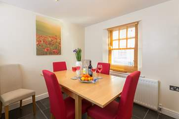 The dining-area is at the far end of the kitchen and there is comfortable seating for the seven guests that the house accommodates.