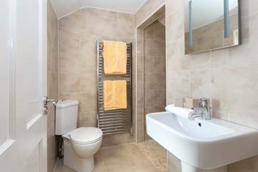The en suite has a great wet-room style shower tucked around the corner.