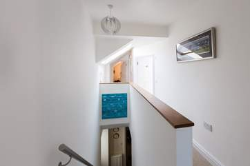 The first floor landing runs the length of the house linking all the bedrooms.