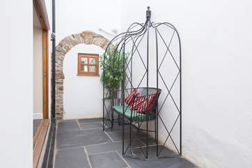 There is a little inner courtyard with bi-fold doors opening from the kitchen.