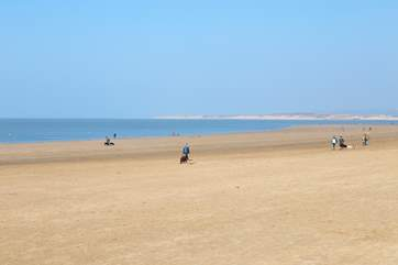 The wonderful sandy beach within steps of your holiday home.