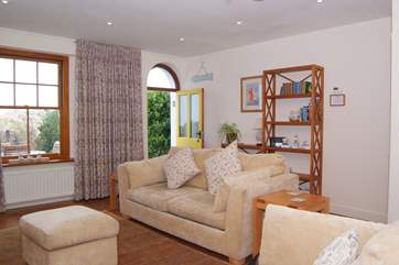 A lovely bright and spacious living room faces towards the front of the house with its enclosed garden and of course the dunes, beach and sea just steps away.
