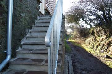 Steps access the cottage and the adjoining footpath leads up to the top of the Beacon.