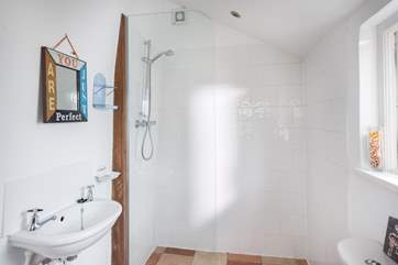 A walk-in shower with under-floor heating.