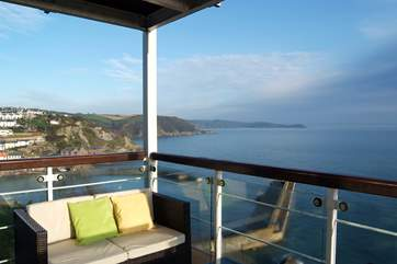 The covered balcony provides a grandstand view of Mevagissey harbour and bay.