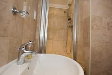 The shower-room en suite to Bedroom 1.
