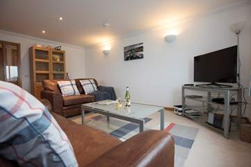 Leather sofas and a big TV for family films and essential sports games!