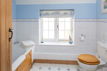 A seaside theme gives the family bathroom a holiday feel.