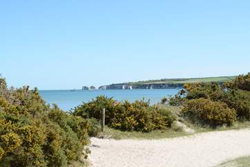 The view from Studland's sandy beach with Old Harry Rocks in the distance, the very beginning of The Jurassic Coast.