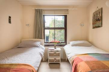 The twin bedroom is decorated in lovely warm colours (Bedroom 2).