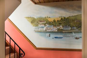 A mural of Flushing decoates the hallway by the bedrooms.