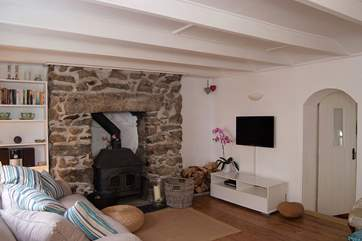 The contemporary style of the cottage interior is complemented by several original character features.