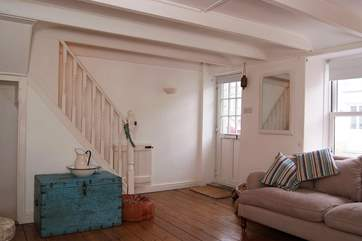The front door opens directly into the light, surprisingly spacious sitting-room.