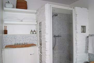 The unexpectedly large bathroom on the ground floor includes a double shower cubicle.