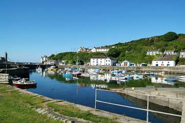 A variety of pubs, shops, cafes and restaurants look out across the pretty harbour.