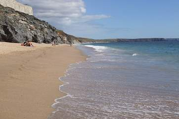 Porthleven Sands, the long beach to the east of the harbour. There are strong undercurrents and submerged rocks which make swimming inadvisable, though popular with experienced surfers.