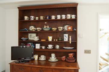 The old oak dresser houses a collection of vintage crockery.