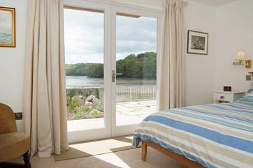 Bedroom 1 has French doors out to the waterside terrace.
