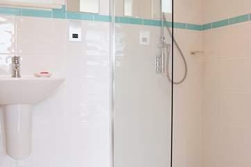 The en suite shower-room to bedroom 1 with large walk-in shower.