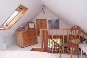 The bedroom is furnished with antique pine.