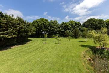 The gardens stretch right up to the boundary trees. Guests are welcome to enjoy them.