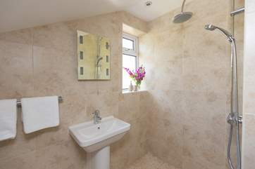 The en suite wet-room is down a couple of steps from the master bedroom.