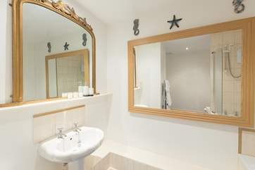 Across the corridor from the second bedroom is a huge bathroom with bath and fitted shower.