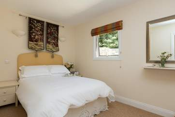 This is the other double bedroom, just as calming and comfortable as the master.