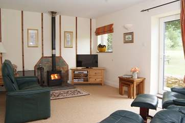 The living-room has a choice of wonderfully comfortable reclining chairs and a wood-burning stove for out-of-season evenings.
