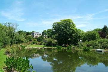 The Owners' beautifully maintained grounds include a large pond and a little stream which runs along the wooded valley.