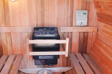 The sauna is a real treat, in a private corner of the garden next to the hot tub.