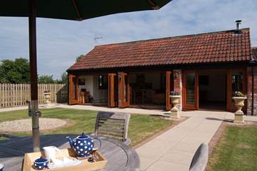 Looking towards the barn with its bi-fold doors opened up all along the front.