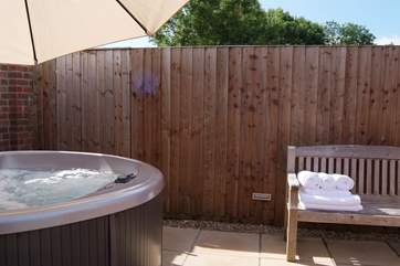Indulge in the hot tub or sauna next to it (just out of the picture) in this sheltered and private corner of the garden.