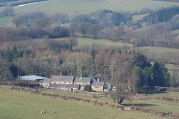 Knighton Farm sits in a sheltered valley. Foxlair Cottage is the cottage at the front. You can buy wonderful home cooked meals and produce from the farm, to enjoy in the cottage or perhaps to take hom
