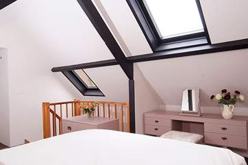 The double bedroom uses the whole of the first floor space.