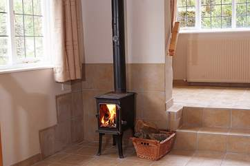 There is a lovely little wood-burner downstairs - please shut the door when in use (the steps are to the dining-area and front door).