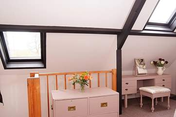 The stairs lead directly into the bedroom and there is plenty of light from the two Velux windows.