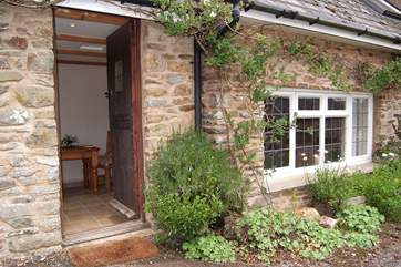 The cottage is prettily planted along the front.