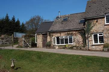 There is a large farmyard in front of the cottage, complete with duck pond.