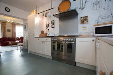 The kitchen leads to the sitting-area.