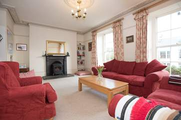 The spacious sitting-room has an electric wood-burner effect stove.