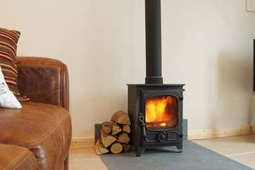 The little wood-burner provides a warming focal point.