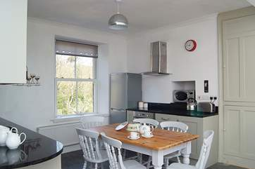 The kitchen units are painted a lovely soft green and are fitted with granite worktops.