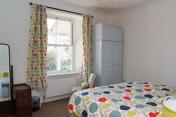 Light and airy ground floor Bedroom 1 has versatile 'zip and link' (double or twin) beds and wonderful sea views.