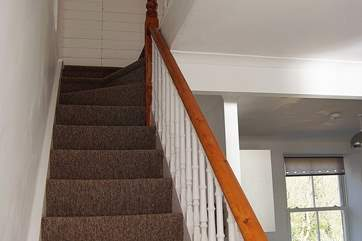 The original cottage staircase turns and divides at the top two steps (please take care).