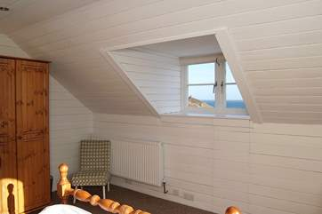 A second window set into the sloping roof allows  light to flood in to Bedroom 2...
