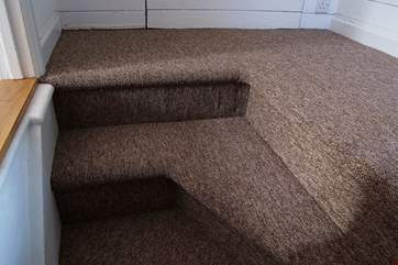 The turning top few steps of the original cottage staircase - please take care when stepping out of the double bedroom!