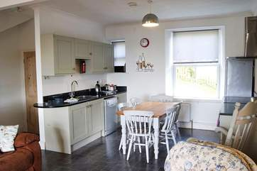 Beyond the living-room are the downstairs bedroom and bathroom, and the utility-room.